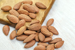 Almonds on a wooden background. Peeled almonds on a wooden background Royalty Free Stock Photography
