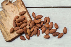 Almonds on a wooden background. Peeled almonds on a wooden background Stock Images