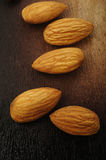 Almonds on wooden background Stock Photography