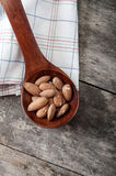 Almonds on wooden background Stock Photos