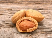 Almonds on wooden background Stock Photo