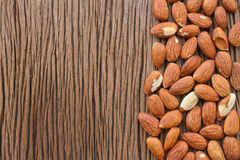 Almonds on wooden background Royalty Free Stock Image