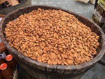 Almonds in a wooden barrel royalty free stock photography