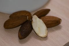 Almonds on a wooden base,. Front view, close up Royalty Free Stock Photography