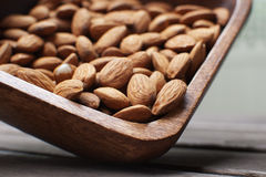 Almonds in wooden bowl. Almonds nuts in wooden bowl Stock Photos