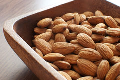 Almonds in wooden bowl Stock Photography