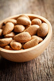 Almonds in wooden bowl Royalty Free Stock Images