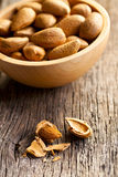 Almonds in wooden bowl Stock Image