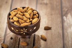 Almonds in a wooden bowl Royalty Free Stock Images