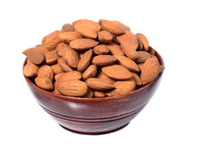 Almonds in a wooden bowl Royalty Free Stock Photo