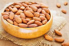 Almonds in wooden bowl on hessian mats Stock Image