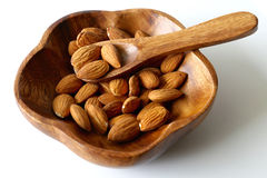 Almonds in wooden bowl. Isolated Stock Images