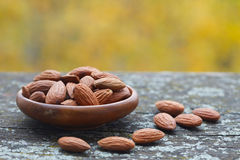 Almonds in wooden bowl Royalty Free Stock Image