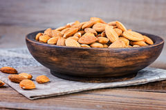 Almonds on a wooden bowl. Stock Image