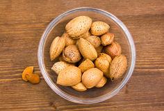 Almonds on wooden bowl on top Stock Image