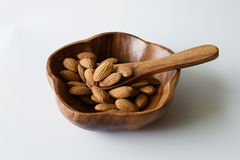 Almonds in wooden bowl Royalty Free Stock Photo