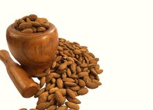 Almonds in wooden bowl on white background . Royalty Free Stock Photos