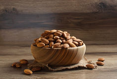 Almonds in wooden brown bowl Stock Images