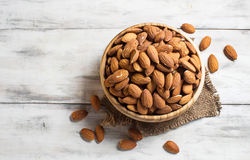 Almonds in wooden brown bowl Royalty Free Stock Image