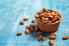 Almonds in wooden brown bowl Royalty Free Stock Photos