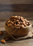 Almonds in wooden brown bowl Royalty Free Stock Photo