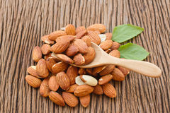 Almonds in wooden scoop Royalty Free Stock Photo