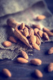Almonds in a wooden scoop Stock Photo
