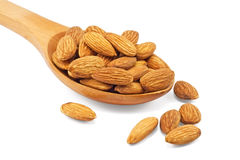 Almonds in wooden spoon Royalty Free Stock Images