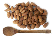Almonds and wooden spoon. Isolated on white background Royalty Free Stock Image