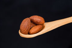 Almonds In Wooden Spoon Stock Photography