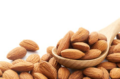 Almonds. On wooden spoon over white background Stock Photography
