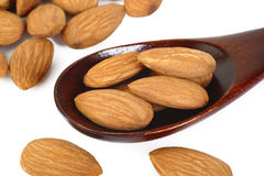Almonds on wooden spoon Stock Image
