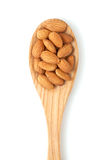 Almonds on wooden spoon Royalty Free Stock Photography