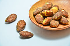 Almonds on wooden spoon Royalty Free Stock Photos