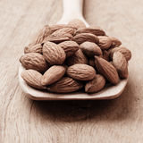 Almonds on wooden spoon Stock Images