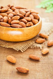 Almonds on wooden table Stock Photos