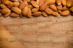 Almonds on wooden table Royalty Free Stock Images