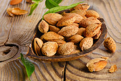 Almonds  on wooden table Royalty Free Stock Photos