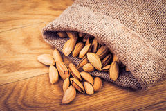 Almonds on wooden table Stock Photography