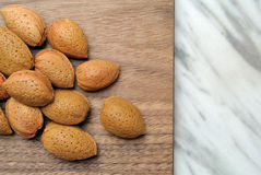 Almonds on wooden top Royalty Free Stock Photos