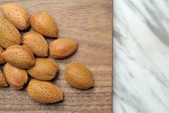 Almonds on wooden top. Almonds on a wooden top Royalty Free Stock Photos