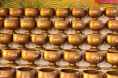 Alms bowl. For donate money in Buddhism royalty free stock photography