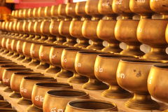 Alms bowl. For donate money in Buddhism royalty free stock photo