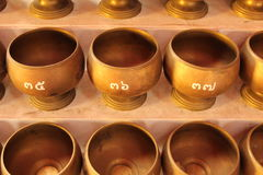 Alms bowl. For donate money in Buddhism stock photography