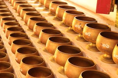 Alms bowl. For donate money in Buddhism royalty free stock images