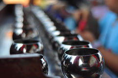 The alms-bowl for merit. On the temple Stock Photo
