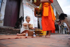 Alms giving ceremony in Luang Prabang,Laos Stock Photography