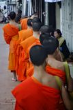 Alms Giving Ceremony in Luang Prabang, Laos. Royalty Free Stock Images