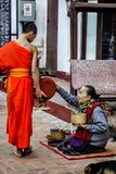 Alms Giving Ceremony in Luang Prabang, Laos. Royalty Free Stock Image