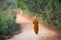 Alms Round of Buddhist Monk in Thailand.  Royalty Free Stock Photos